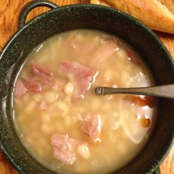 Navy Bean Soup with Ham Recipe - Use smoked ham hocks to add hearty flavor to a navy bean soup made from scratch.