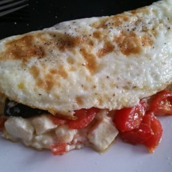 Spinach, Tomato, and Feta Egg White Omelette Recipe - Egg white omelette stuffed with spinach, tomato, and feta cheese is an easy and filling way to start the day.