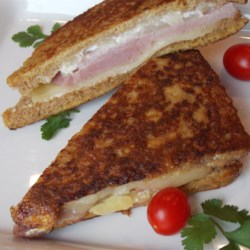 Ham and Pineapple Fried Sandwiches Recipe - This kid-friendly sandwich is yummy and easy to make for lunch and snacks. Sort of in between a grilled cheese and a Monte Cristo.