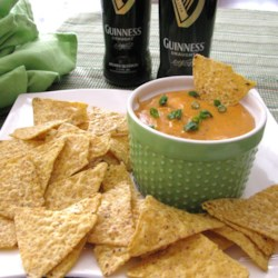 Guinness(R) Beer Cheese Dip Recipe - Guinness(R) Irish stout cheese dip is perfect for dipping pretzels and tortilla chips at your next party.
