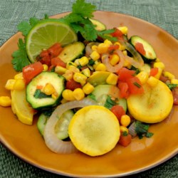 Southwestern Veggie Skillet Recipe - This southwestern-inspired veggie skillet is loaded with squash, corn, and tomatoes and sprinkled with cilantro and lime juice and is a perfect accompaniment to meals.
