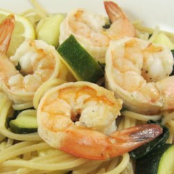 Shrimp Spaghetti in Olive Oil Dressing Recipe - A quick olive oil dressing is all it takes to season this light shrimp and pasta dinner, bursting with colorful summer veggies like zucchini and yellow squash.