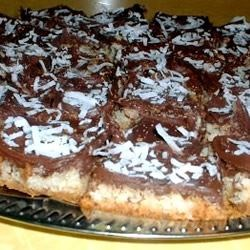 Triple Layer Cookie Bars Recipe - Gooey cookie bars, rich with chocolate, peanut butter and coconut.