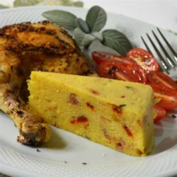 Torta De Polenta Recipe - Sage and roasted peppers add zip to this tasty way to eat polenta.