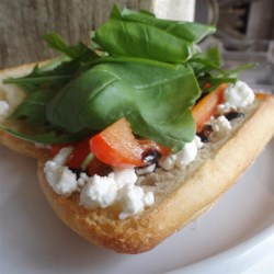 Roasted Red Pepper Sub Recipe - A toasted baguette is filled with roasted red pepper, goat cheese, arugula, and basil in this simple sandwich recipe.