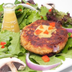 Simple Salmon Cakes Made with Oatmeal Recipe - This is a basic recipe for homemade salmon patties made with oatmeal and fried in a mixture canola oil and butter.