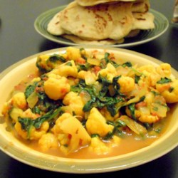 Spinach and Cauliflower Bhaji Recipe - Cauliflower and spinach are simmered in a curry-flavored tomato broth for a warm and fragrant dish. Serve with roti breads for a complete meal.