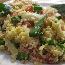 Mediterranean Couscous Recipe - This quick side dish features chopped artichoke hearts and fresh tomato with feta cheese and parsley mixed into couscous.