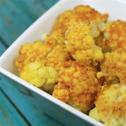 Quick Curried Cauliflower Recipe - A coating of curried mayonnaise and yogurt is spread on a whole head of cauliflower. It is then cooked in the microwave for a quick vegetable side dish or appetizer.