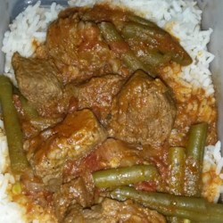 Arabic Green Beans with Beef Recipe - Green beans are simmered with a spicy beef and tomato sauce in this recipe.