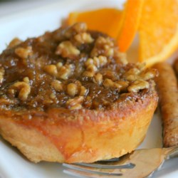 Orange Pecan French Toast Recipe - A simple baked French toast that won't have you slaving over a hot stove. An orange batter and caramel pecan coating make this baked French toast so delicious, you won't need any syrup.