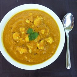 Curried Cream of Cauliflower Soup Recipe - This creamy cauliflower soup gets a double shot of robust flavor from roasting the cauliflower and a mixture of curry powder, cayenne pepper, and turmeric.