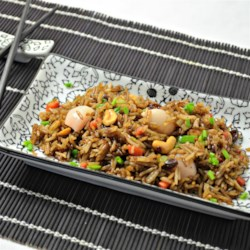 Fried Rice with Lychees (Koa Pad Lin Gee) Recipe - Sweet lychees and raisins add a pleasant sweetness to this delicious rice dish.