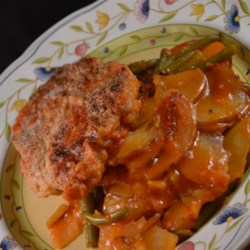 Saucy Chops I Recipe - Flavorful and filling pork chops simmered with green beans, potatoes in a tomato sauce.
