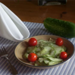 Cucumber Salad II Recipe - The most difficult task in making this salad is getting the cucumbers and onions very, very thin. When that 's done, just pour on the creamy dressing and chill.