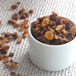 Grandma Dalley's Honey Granola Recipe - Homemade honey granola sprinkled with almonds and golden raisins just like grandma used to make is a quick and easy breakfast treat.