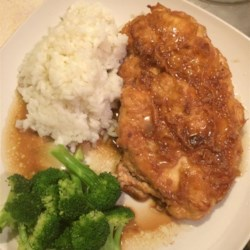 Chicken French - Rochester, NY Style Recipe - Chicken breasts get a savory coating flavored with Parmesan cheese, then are quickly pan fried and served with a light lemon-sherry sauce with a hint of garlic.
