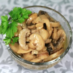 Mary McCormack's Marinated Mushrooms Recipe - In this hors d 'oeuvres, canned mushrooms are marinated in a vinegar and olive oil dressing.