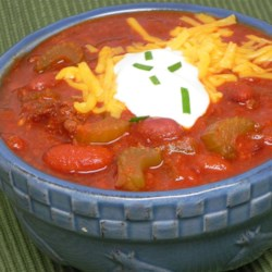 Beef and Chorizo Chili Recipe - Chorizo brings extra flavor to this easy ground beef chili recipe that goes great on hot dogs or in a bowl.