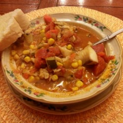 Spicy Catfish Chowder Recipe - Catfish flavors this veggie-rich and spicy chowder made with zucchini, tomatoes, and canned sweet corn.