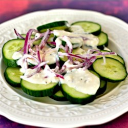 Summertime Cucumber Salad Recipe - This simple and fast summertime recipe is little more than cucumbers and onion in creamy salad dressing with vinegar and sugar.