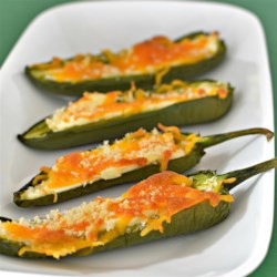 Baked Jalapeno Poppers Recipe - Forego the frying but keep all the goodness of Cheddar- and cream cheese-stuffed jalapenos with this recipe for baked jalapeno poppers.