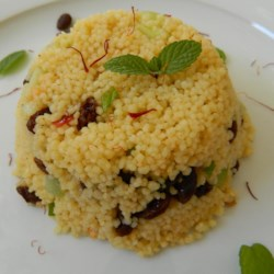 Saffron Couscous Recipe - Saffron couscous, tossed with currants and seasoned with cumin and harissa, is a light side dish or a hearty lunch.