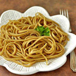 Spaghetti with a Twist Recipe - Marinate cooked spaghetti in a deeply flavorful blend of beef boullion, sauteed garlic and dashes of soy sauce for an exotic side dish. Garnish with toasted sesame seeds and thinly sliced scallions, if desired.