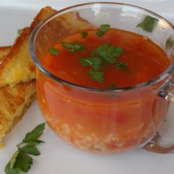 Prosciutto Fave Minestrone alla Riso  Recipe - Ham, beans and rice are featured in this hearty soup with tomatoes.