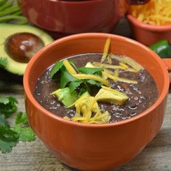 Easy and Super Delicious Black Bean Soup Recipe - You can quickly prepare a tasty black bean soup with canned beans, vegetable broth, salsa, and Cheddar cheese.