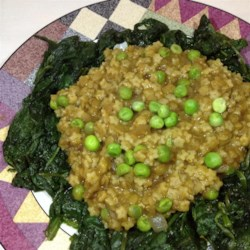 Curried Quinoa with Red Lentils and Kale Recipe - Curried quinoa with red lentils and kale is a hearty vegetarian dish with a slightly sweet and savory mix of flavors.