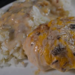 Chelan Chicken  Recipe - This is a family-pleasing and comforting recipe of breaded and lightly fried chicken breasts baked in a creamy mushroom wine sauce.