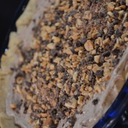 Chocolate Peanut Butter Pie III Recipe -  You can make and enjoy this chunky pie in about an hour. Cream cheese, peanut butter, chocolate chips and whipped topping are mixed together, plopped into a baked crust and chilled.