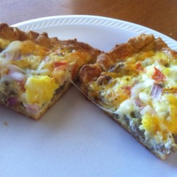 Breakfast Pizza Recipe - A crust made from crescent roll dough contains favorite breakfast foods like eggs, sausage, and hash browns.