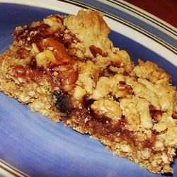 Oatmeal Jam Squares Recipe - A layered treat, with the sweet taste of fruit combined with the crunch and wholesomeness of the oat mixture.
