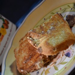Grilled Smores Sandwich Recipe - The peanut butter sandwich gets fancy when marshmallow creme and Nutella(R) are added, creating a quick and easy grilled smores sandwich.