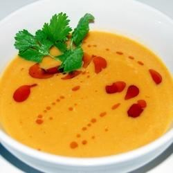 Spicy Sweet Potato and Coconut Soup Recipe - Sweet potato soup is made Asian style with coconut milk and curry paste. This soup is easy to make and unbelievably good!