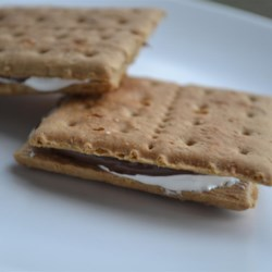 Easy No-Cook Nutella(R) Smores Recipe - Everyone's favorite chocolate-hazelnut spread, Nutella(R), is spread on graham crackers with marshmallow fluff in this recipe for easy smores.