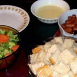 Baby Swiss Cheese Fondue Recipe - Cheese fondue, made with Baby Swiss cheese, gets a bit of a kick from mustard!