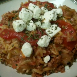 Greek Lamb and Orzo Recipe - Orzo pasta is simmered with tomatoes and browned lamb in this Greek-inspired dish.