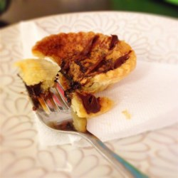 Chocolate Butter Tarts Recipe - Butter tarts don't have to be traditional - these butter tarts have a hidden layer of chocolate.