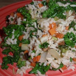 Brown Rice and Kale Salad Recipe - This brown rice and kale salad with plenty of vegetables and almonds is a hearty lunch or a side salad alongside steak.
