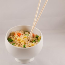 Take Out-Style Fried Rice Recipe - Simple fried rice just like take-out is easy to prepare using cooked rice, carrots, peas, and a hint of soy sauce.