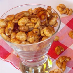 Cajun Sugared Peanuts Recipe - These homemade glazed peanuts use a bit of chipotle pepper and chili powder to add some heat to a favorite sweet treat.