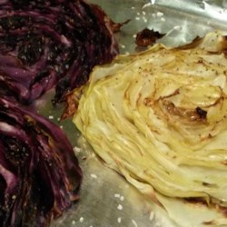 Easy Roasted Cabbage Recipe - Cut a head of cabbage into slices, brush with olive oil, season with salt and pepper, and roast until tender to make this delicious roasted cabbage dish.