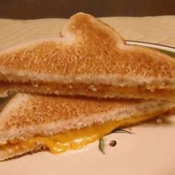 Bachelor Grilled Cheese Recipe - Quick and easy grilled cheese for the man who doesn't need to impress anyone with his cooking abilities! A cunning approach for making grilled cheese without using the stove.