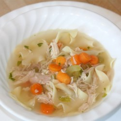 Awesome Chicken Noodle Soup Recipe - Homemade chicken stock flavored with lemon grass is combined with carrots, celery, egg noodles and chicken in this heartwarming soup.