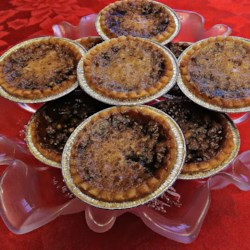Honey Butter Tarts Recipe - This butter tart recipe features a mixture of honey and brown sugar, with lemon juice for a little zing.