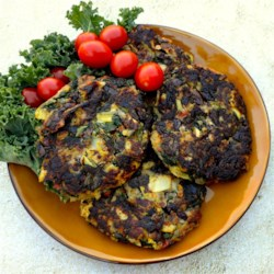 Mediterranean Vegetable Cakes Recipe - Mediterranean vegetables cakes, made with artichoke hearts, Kalamata olives, and almond flour, are a tasty, gluten-free side or main dish.