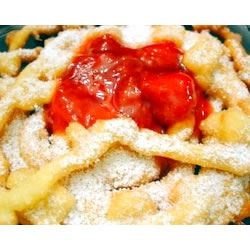 Funnel Cakes I Recipe - A puffed fried cake. It can be sprinkled with confectioners' sugar or cinnamon sugar.
